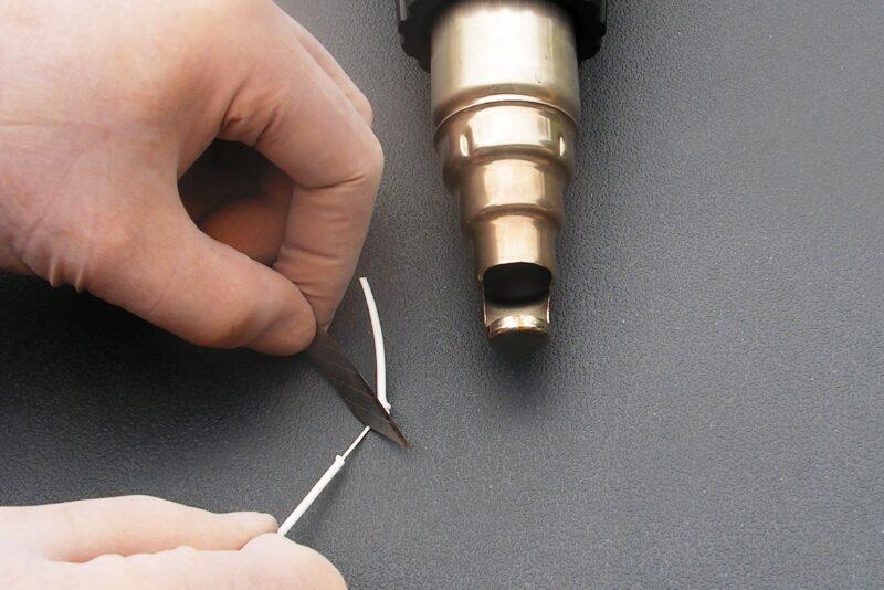 Fjern coatingen med bagsiden af knivryggen
